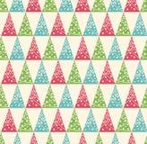 Nahtloses Winter-Muster mit stilisierten Dekorations-Weihnachtsbäumen Stockfotos