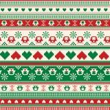 Nahtloses Winter-Strickjackenmuster mit Herzen und Eulen. Rot-grün Stockfotografie