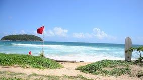 Nai Harn beaches of Phuket, Thailand. Beach warning red flags wind and wave rage at Nai Harn beaches of Phuket, Thailand stock footage