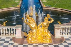 Naiad Triton fountain. View from the terrace of the Grand Palace to the Fountain Naiad Triton in the Central Part of The Lower Park in the Peterhof State Museum Royalty Free Stock Images