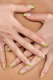 Nail. Hand with careful manicure on the stomach Stock Images