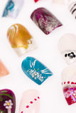 Nail art. A variation of acrylic fingernails with creative designs stock images