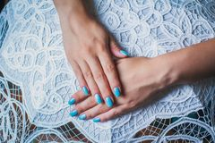 Nail art with blue background and white lace. On lace umbrella Stock Photos