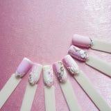 Nail art design with rhinestones on pink background. Nail art design with rhinestones on pink background stock photos