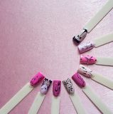 Nail art design with thin lines on the pink background. Nail art design with thin lines on the pink background royalty free stock photos