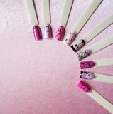 Nail art design with thin lines on the pink background. Nail art design with thin lines on the pink background stock photo