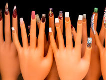Nail Art. Display of nail extension art samples on mannequin hands in a shop window royalty free stock image