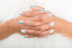 Nail art. Fingers interlaced and nail art Royalty Free Stock Photography