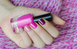 Nail art with glitter. Beautiful female hand with pink manicure. Stock Photography