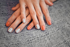 Nail art. And knitted sweater stock photo