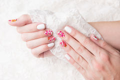Nail art with lace. Nail art with white lace royalty free stock photos