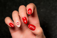 Nail art. Manicure and nail art with message Royalty Free Stock Photo