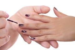Nail Art. Modern nail art with patterns and custom polish designs royalty free stock photos