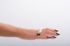Nail art and pearls Royalty Free Stock Images