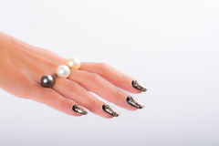 Nail art and pearls Stock Photography