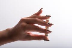 Nail art and pearls Stock Photo