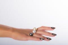 Nail art and pearls Royalty Free Stock Photos