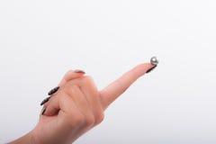 Nail art and pearls Stock Photos