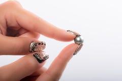 Nail art and pearls Royalty Free Stock Photo