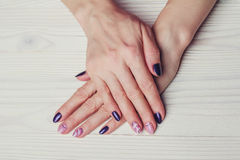 Nail art with purple and pink colors Stock Images