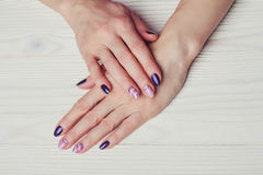 Nail art with purple and pink colors Stock Photography