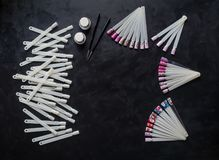 Nail art samples on the black table. Top view. royalty free stock photo