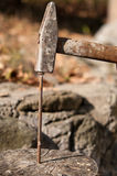 Nail being pounded into wood by hammer Stock Photography