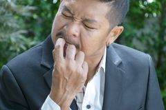 Nail biting.Businessmen born are nervous royalty free stock photos