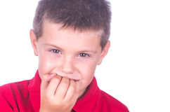 Nail biting child. On white background Stock Photography