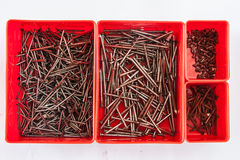 Nail in box. Many size of nail in a red box Royalty Free Stock Images