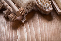 Nail brush loofah and wooden massagers on pine Royalty Free Stock Photography