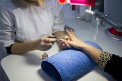 Nail care at beauty salon Royalty Free Stock Images