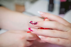 Nail care, manicure in a beauty salon Stock Image