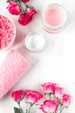 Nail care spa set with rose cream, towel white background top view Royalty Free Stock Photo