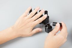Nail care. viewing varnished nails. copy space. Nail care. viewing varnished nails. Light background Stock Photography
