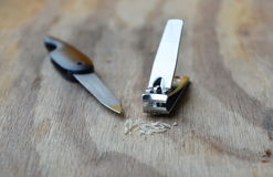 Nail clipper and emery file on wooden board Royalty Free Stock Photography