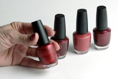 Nail Color Selection. Selecting the right red color Stock Photos