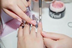 Nail creation the beauty salon royalty free stock photo