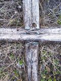 Nail cross. Old fallen cross in Catholic graveyard Royalty Free Stock Image