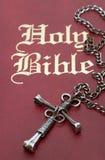 Nail Cross on Bible Stock Photos