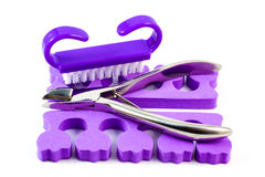 Nail cutters over spacers Royalty Free Stock Images