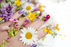 Nail design with flowers. Royalty Free Stock Photo