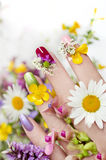Nail design with flowers. stock photos