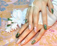 Nail design: green Python. With gold streaks royalty free stock image