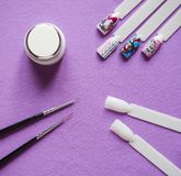 Nail design kit. The concept drawings on the nails. royalty free stock images