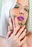 Nail design and makeup with green dots royalty free stock image