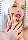 Nail design and makeup with green dots stock image