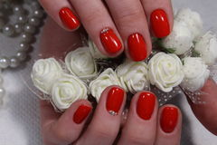 Nail design with red flower stock images