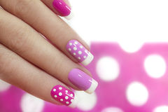Nail design with white dots. Royalty Free Stock Photos
