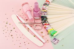 Nail designs on tips and manicure set. On a colored background stock photo